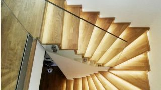 Stairs in a duplex flat, solved with a lighting design variation